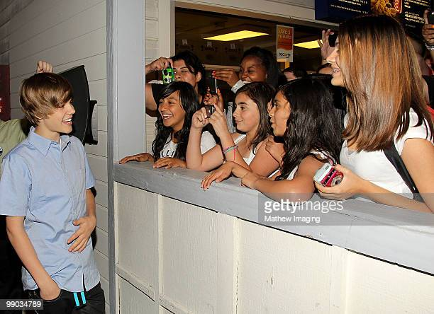 VALENCIA CA MAY 08 Justin Bieber talks with park guests during his visit to Six Flags Magic Mountain on May 8 2010 in Valencia California