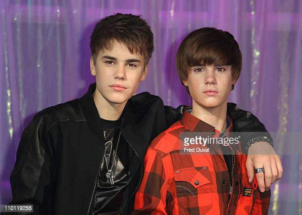 Justin Bieber unveils his wax work at Madame Tussauds on March 15, 2011 in London, England.