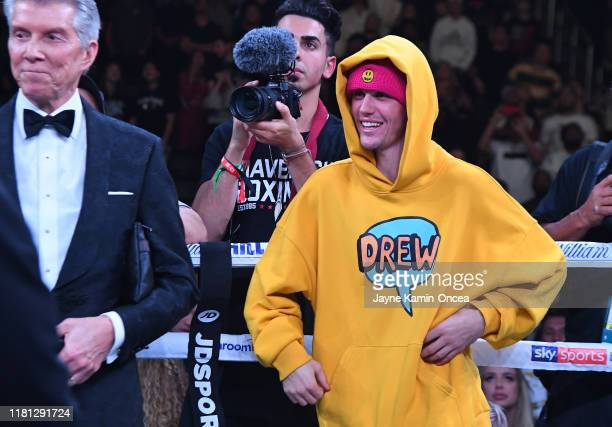 Justin Bieber waits in the ring after the fight between KSI and Logan Paul at Staples Center on November 9 2019 in Los Angeles California KSI won by...