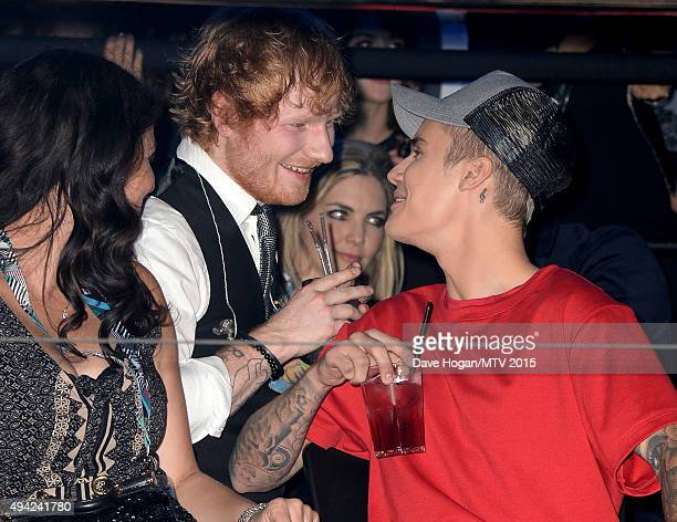 Justin Bieber watches the show with Ed Sheeran from the Glamour pit during the MTV EMA's 2015 at the Mediolanum Forum on October 25 2015 in Milan...