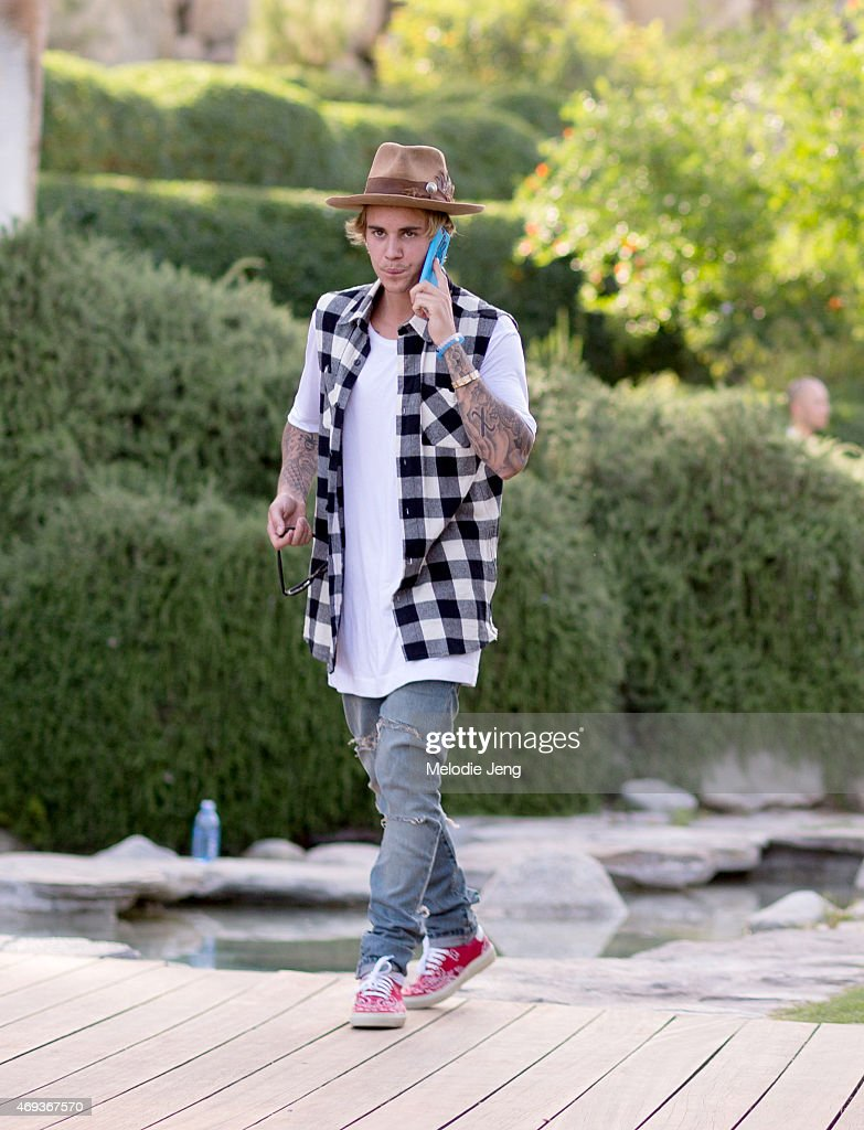 Justin Bieber, wearing a Nick Fouquet hat, attends the Views from The One party at The dFm House during the 2015 Coachella Valley Music And Arts Festival on April 10, 2015 in Palm Springs, California.