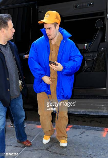 Justin Bieber wears a bright tan and blue outfit on March 5 2019 in New York City