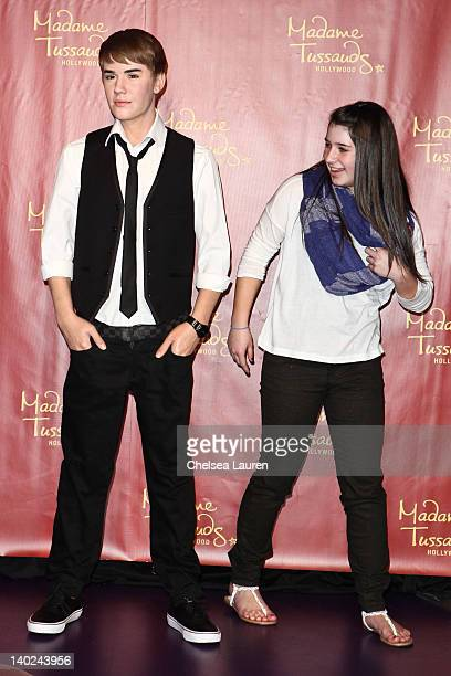 Justin Bieber's biggest fan Alisha Purdom unveils the new Justin Bieber figure on his 18th Birthday at Madame Tussauds on March 1 2012 in Hollywood...