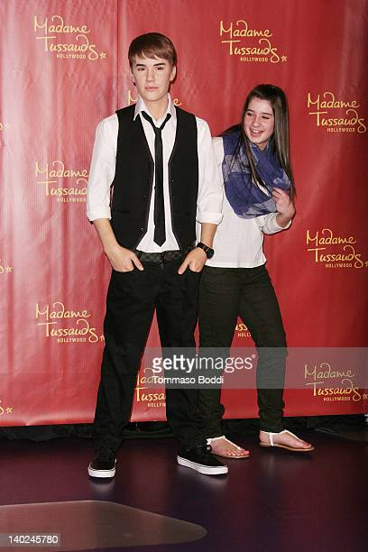 Justin Bieber's biggest fan Alisha Purdom unveils the new Justin Bieber wax figure to celebrate his 18th birthday at Madame Tussauds on March 1 2012...