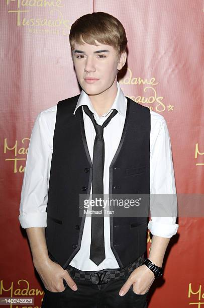 Justin Bieber's biggest fan unveils the new Bieber wax figure at Madame Tussauds Hollywood on the singer's 18th Birthday on March 1 2012 in Hollywood...