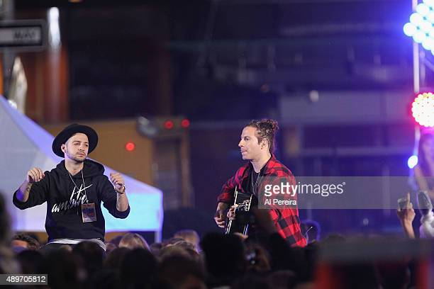 Justin Bieber's manager Scooter Braun and Guitarist Dan Kanter perform in the rain on NBC's 'Today' Show at Rockefeller Plaza on September 10 2015 in...