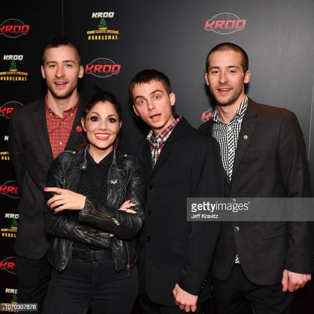 Justin Bivona Aimee Allen Kevin Bivona and Jesse Bivona of The Interrupters pose during KROQ Absolut Almost Acoustic Christmas 2018 at The Forum on...