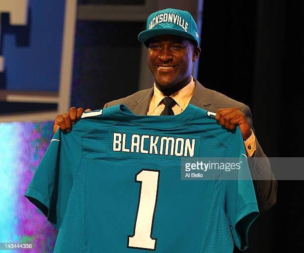Justin Blackmon from Oklahoma State holds up a jersey as he stands on stage after he was selected overall by the Jacksonville Jaguars in the first...