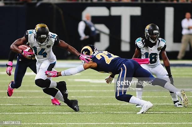 Justin Blackmon of the Jacksonville Jaguars avoids the tackle of Trumaine Johnson of the St Louis Rams at the Edward Jones Dome on October 6 2013 in...