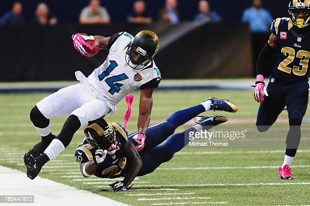 Justin Blackmon of the Jacksonville Jaguars is tackled out of bounds by Darian Stewart of the St Louis Rams during a game against the St Louis Rams...