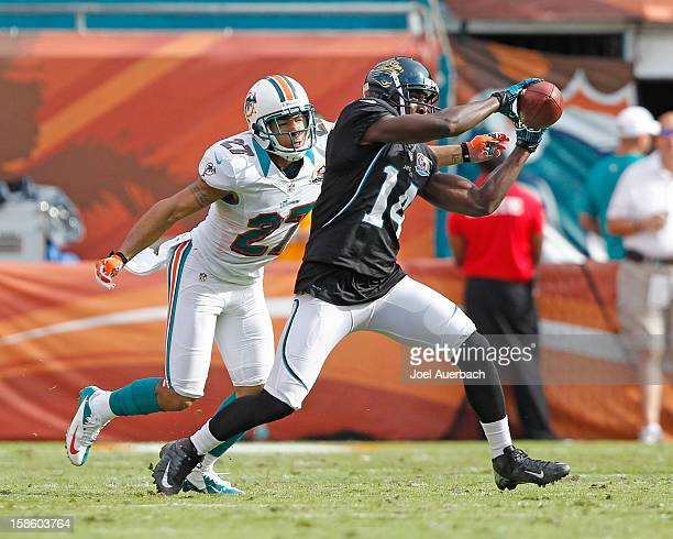 Justin Blackmon of the Jacksonville Jaguars is unable to catch the ball while being defended by Jimmy Wilson of the Miami Dolphins on December 16...