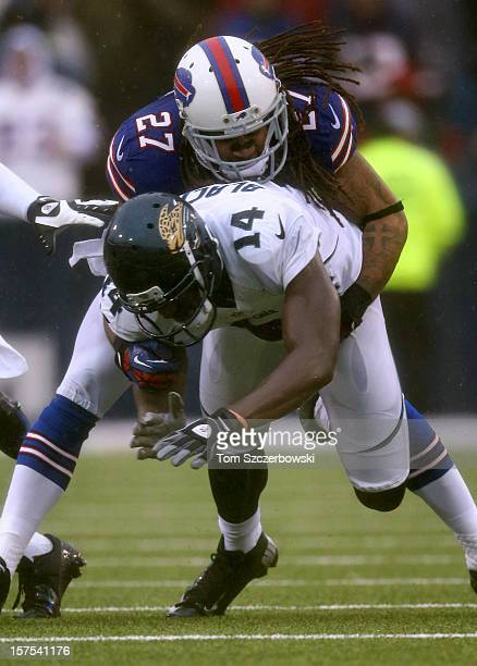 Justin Blackmon of the Jacksonville Jaguars loses the ball during an NFL game as he is tackled by Stephon Gilmore of the Buffalo Bills at Ralph...