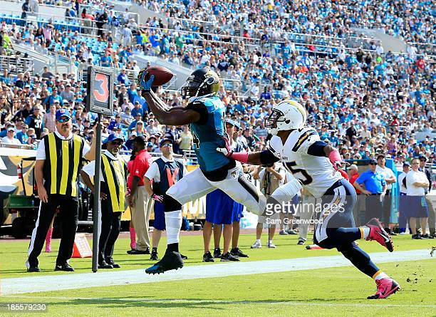 Justin Blackmon of the Jacksonville Jaguars makes a reception against Darrell Stuckey of the San Diego Chargers during the game at EverBank Field on...