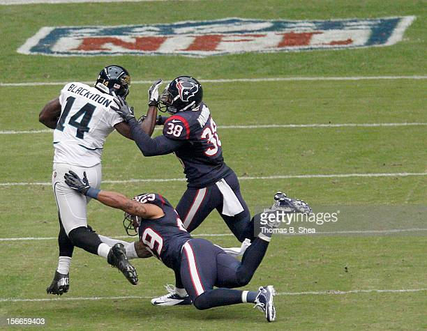 Justin Blackmon of the Jacksonville Jaguars tries to fend off Danieal Manning of the Houston Texans and Glover Quin of the Houston Texans on November...