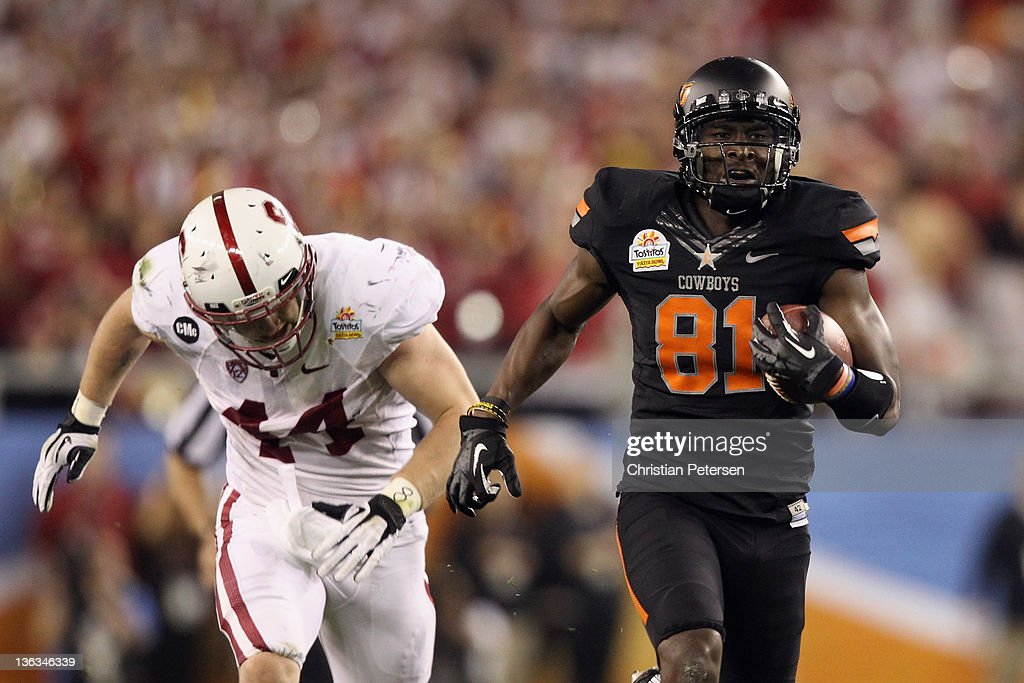 Justin Blackmon #81 of the Oklahoma State Cowboys catches a 67-yard touchdown reception in the second quarter against Chase Thomas #44 of the Stanford Cardina during the Tostitos Fiesta Bowl on January 2, 2012 at University of Phoenix Stadium in Glendale, Arizona.