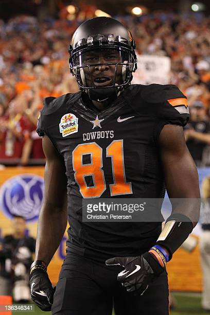Justin Blackmon of the Oklahoma State Cowboys celebrates after he caught a 67yard tocudown reception in the second quarter against the Stanford...