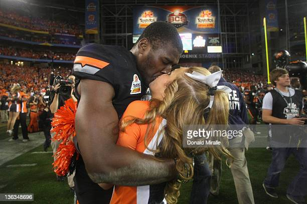 Justin Blackmon of the Oklahoma State Cowboys celebrates with a cheerleader after Oklahoma State Cowboys won 4138 in overtime against the Stanford...
