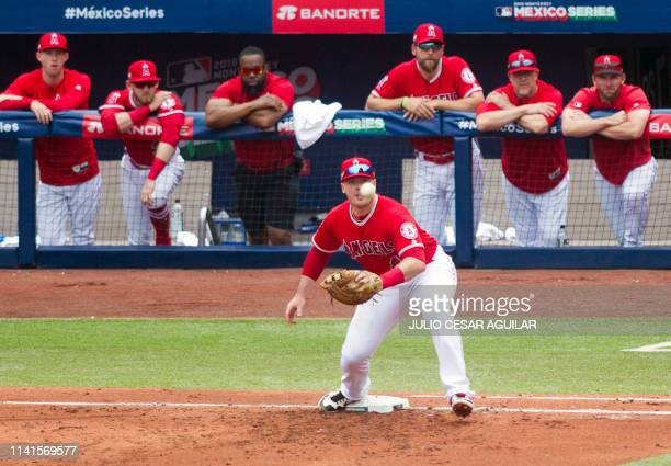 Justin Bour of Los Angeles Angels eyes the ball during the second inning of the MLB game against Los Angeles Angels at Monterrey Stadium in Monterrey...