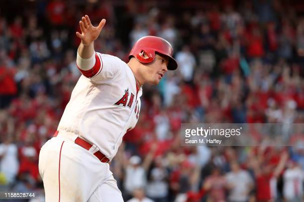 Justin Bour of the Los Angeles Angels of Anaheim reacts after hitting a three-run homerun during the eighth inning of a game against the Cincinnati...