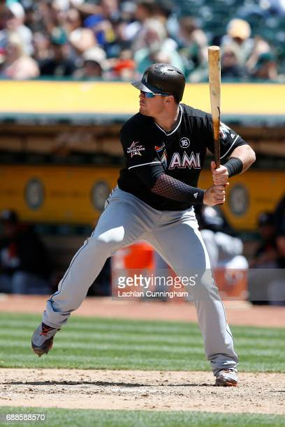 Justin Bour of the Miami Marlins at bat in the seventh inning against the Oakland Athletics at Oakland Alameda Coliseum on May 24 2017 in Oakland...