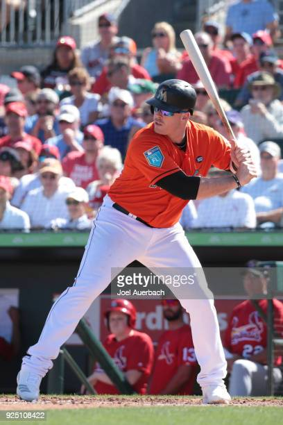 Justin Bour of the Miami Marlins bats against the St Louis Cardinals during a spring training game at Roger Dean Chevrolet Stadium on February 23...