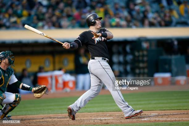 Justin Bour of the Miami Marlins bats during the game against the Oakland Athletics at the Oakland Alameda Coliseum on May 23 2017 in Oakland...