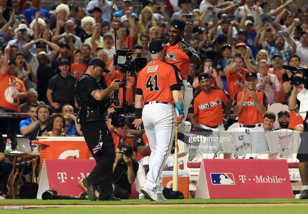 Justin Bour #41 of the Miami Marlins celebrates with Marcell Ozuna #13 of the Miami Marlins and the National League during the T-Mobile Home Run Derby at Marlins Park on July 10, 2017 in Miami, Florida.