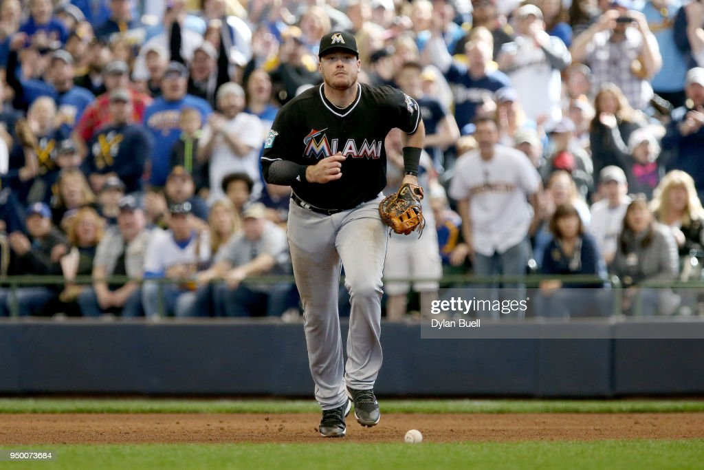 Justin Bour #41 of the Miami Marlins chases after the ball after committing an error in the seventh inning against the Milwaukee Brewers at Miller Park on April 22, 2018 in Milwaukee, Wisconsin.