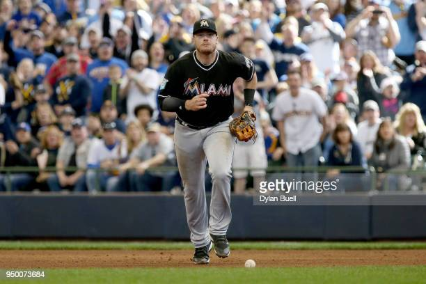 Justin Bour of the Miami Marlins chases after the ball after committing an error in the seventh inning against the Milwaukee Brewers at Miller Park...