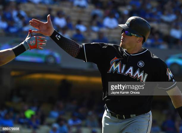 Justin Bour of the Miami Marlins crosses the plate after a solo home run in the ninth inning against the Los Angeles Dodgers at Dodger Stadium on May...