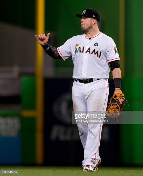 Justin Bour of the Miami Marlins gestures during the game against the Atlanta Braves at Marlins Park on October 1 2017 in Miami Florida