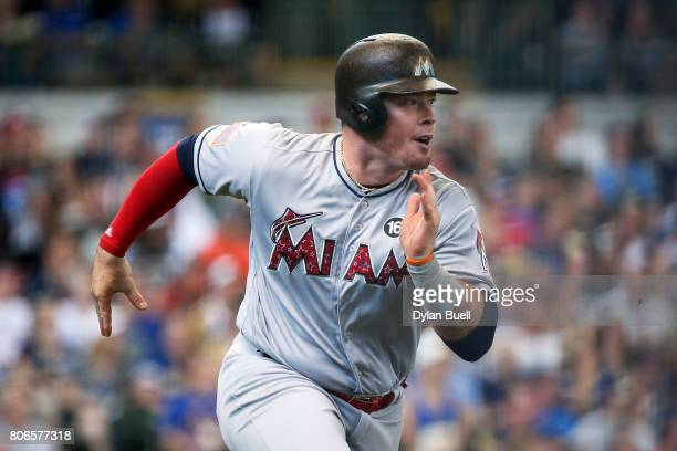 Justin Bour of the Miami Marlins hits a double in the first inning against the Milwaukee Brewers at Miller Park on July 01 2017 in Milwaukee Wisconsin