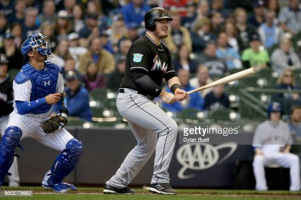 Justin Bour of the Miami Marlins hits a double in the first inning against the Milwaukee Brewers at Miller Park on April 22 2018 in Milwaukee...