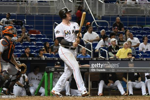Justin Bour of the Miami Marlins hits a home run in the eighth inning against the Houston Astros at Marlins Park on May 15 2017 in Miami Florida