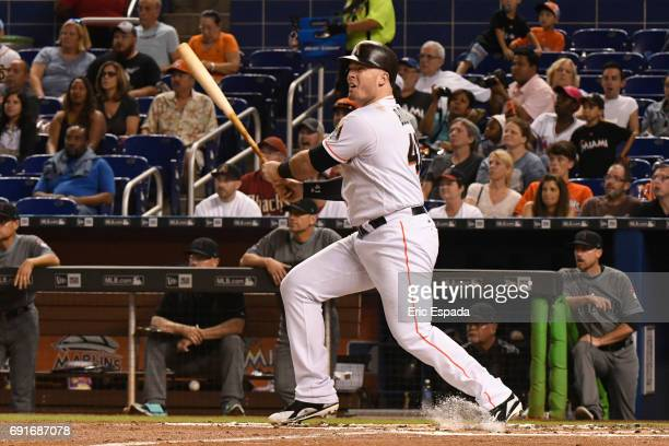Justin Bour of the Miami Marlins hits a home run in the first inning against the Arizona Diamondbacks at Marlins Park on June 2 2017 in Miami Florida