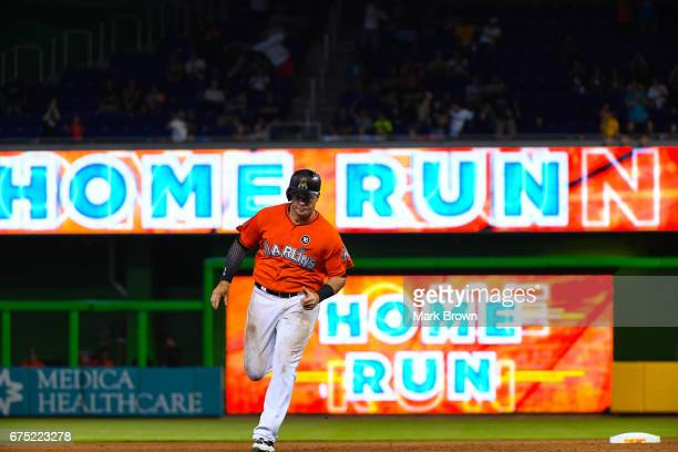 Justin Bour of the Miami Marlins hits a home run in the seventh inning during the game between the Miami Marlins and the Pittsburgh Pirates at...