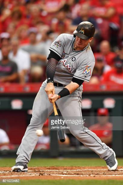 Justin Bour of the Miami Marlins hits a lead off single in the second inning against the Cincinnati Reds at Great American Ball Park on July 22 2017...