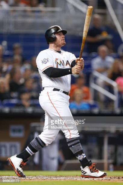 Justin Bour of the Miami Marlins hits a pinch hit tworun home run in the seventh inning against the Pittsburgh Pirates at Marlins Park on April 15...