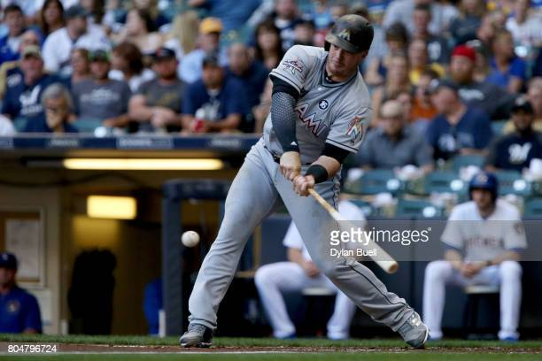 Justin Bour of the Miami Marlins hits a single in the second inning against the Milwaukee Brewers at Miller Park on June 30 2017 in Milwaukee...