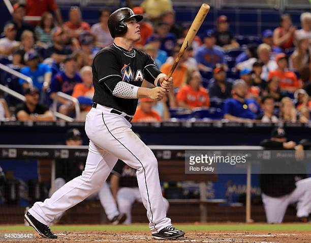Justin Bour of the Miami Marlins hits a three run home run during the fourth inning of the game against the Chicago Cubs at Marlins Park on June 25...