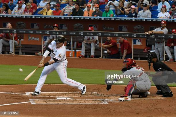Justin Bour of the Miami Marlins hits a three run home run in the first inning against the St Louis Cardinals at Marlins Park on May 10 2017 in Miami...