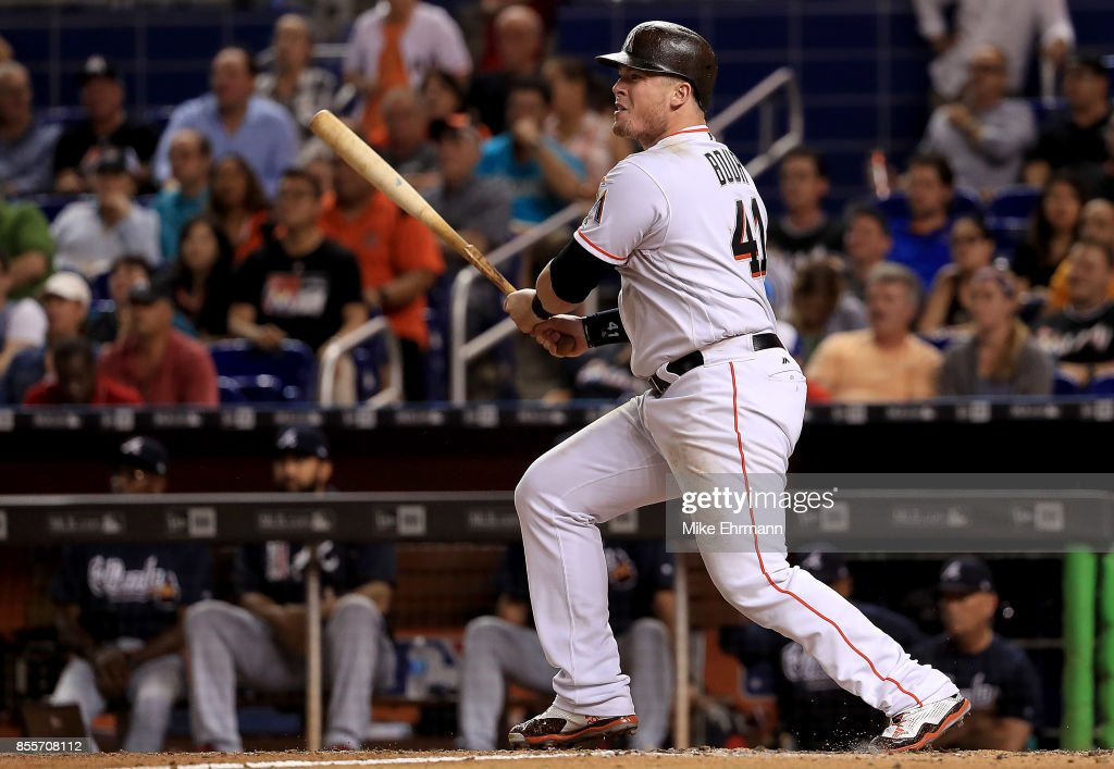 Justin Bour #41 of the Miami Marlins hits a two RBI double in the seventh inning during a game against the Atlanta Braves at Marlins Park on September 29, 2017 in Miami, Florida.