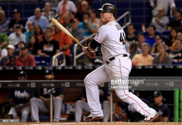 Justin Bour of the Miami Marlins hits a two RBI double in the seventh inning during a game against the Atlanta Braves at Marlins Park on September 29...