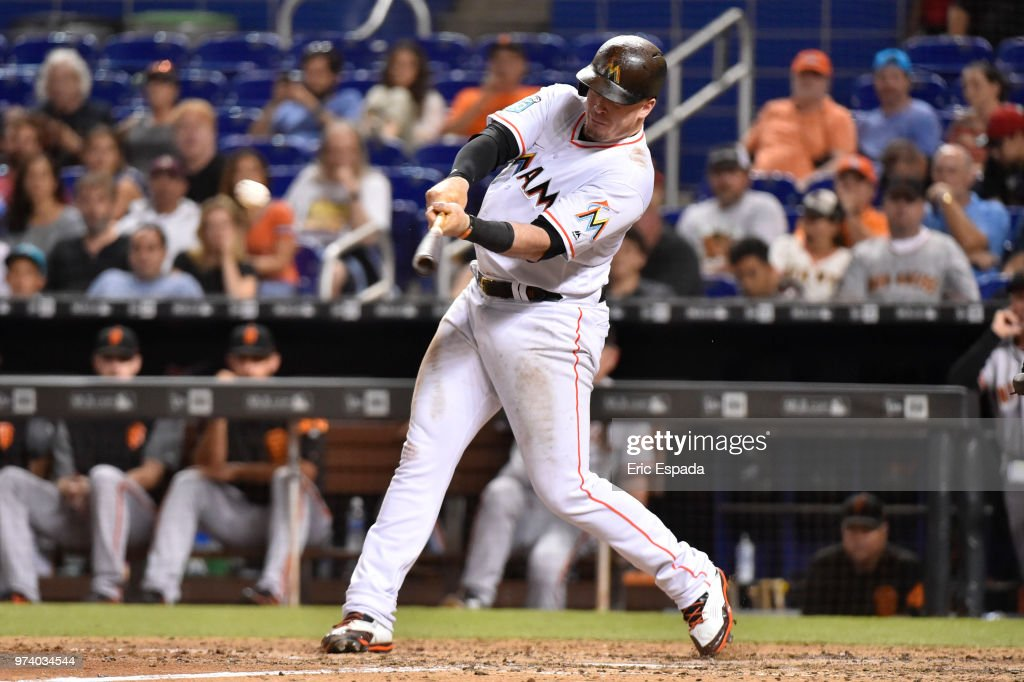 Justin Bour #41 of the Miami Marlins hits an RBI double in the eighth inning against the San Francisco Giants at Marlins Park on June 13, 2018 in Miami, Florida.