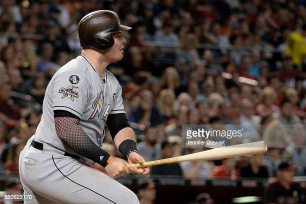 Justin Bour of the Miami Marlins hits an RBI single against the Arizona Diamondbacks in the third inning at Chase Field on September 23 2017 in...