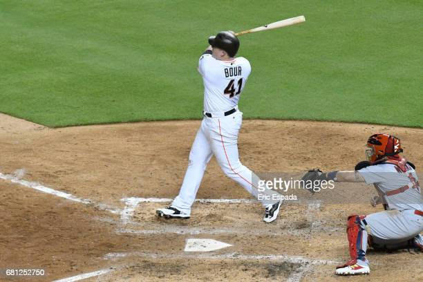 Justin Bour of the Miami Marlins hits an RBI single in the sixth inning against the St Louis Cardinals at Marlins Park on May 9 2017 in Miami Florida
