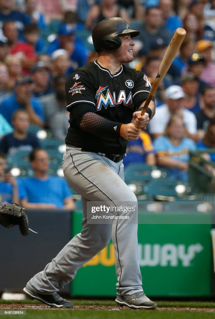 Justin Bour #41 of the Miami Marlins hits sacrifice fly ball during the first inning of their game against Milwaukee Brewers at Miller Park on September 16, 2017 in Milwaukee, Wisconsin.