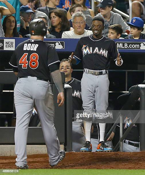 Justin Bour of the Miami Marlins is congratulated by teammate Dee Gordon after Bour hit a solo home run in the eighth inning against the New York...