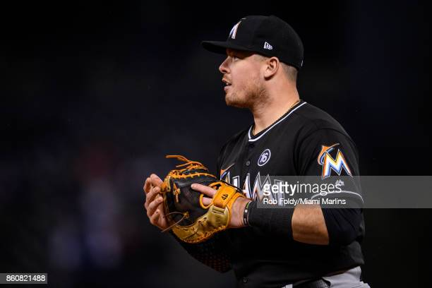 Justin Bour of the Miami Marlins looks on during the game against the Colorado Rockies at Coors Field on September 26 2017 in Denver Colorado