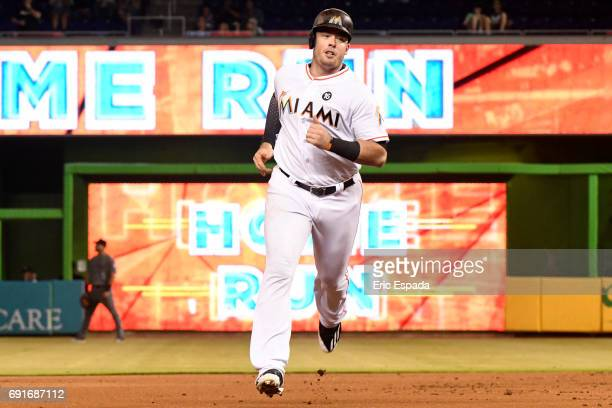 Justin Bour of the Miami Marlins rounds second base after hitting a home run in the first inning against the Arizona Diamondbacks at Marlins Park on...